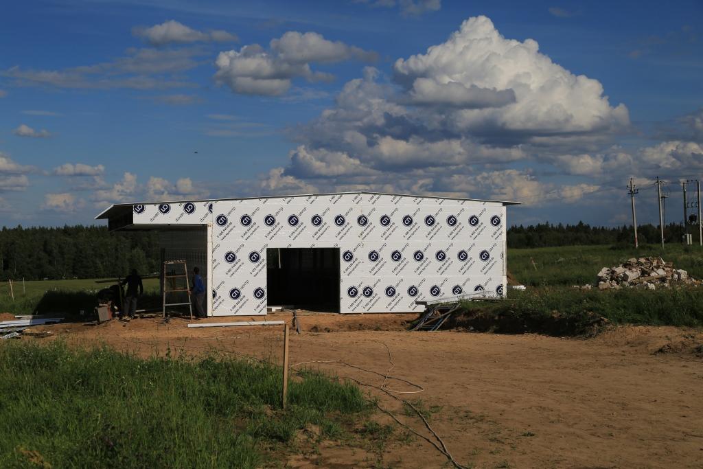 Здание для дойки коров